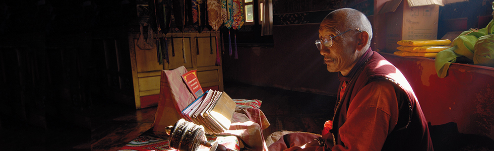 Buddhist monk studying in Namling Monastery - East Tibet